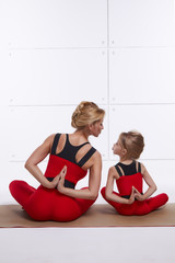 Mother and daughter doing yoga family sports, sports paired