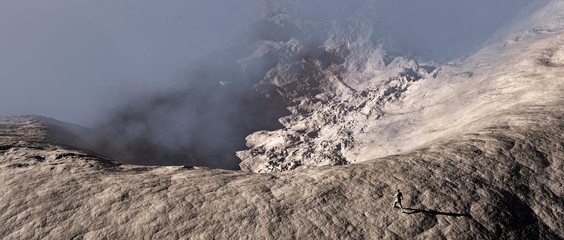 Hiker walking towards edge of a cliff. Aerial shot.