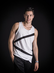 Portrait of friendly young man smiling in white tank-top