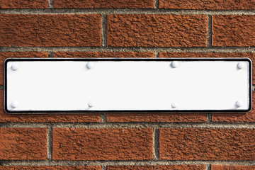 Blank sign on red brick wall