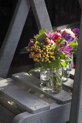 decoration of dining table. bouquet of dahlia in vase of glass.