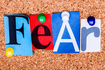 The word FEAR on a bulletin board