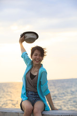 beautiful young woman happy emotion at sea side