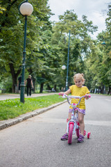 Girl rides bicycle