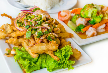 Spicy deep fried squid mingle serve with broccoli prawn salad. A