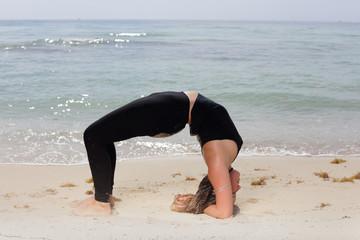 Setu Bandha Sirsasana yoga pose stock image
