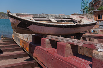 Old fishing boat being repaired at a small shipyard