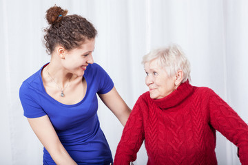 Elderly woman and her smiling granddaughter