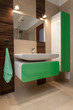 Designed bathroom with green elements