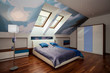 Interior of blue and white bedroom