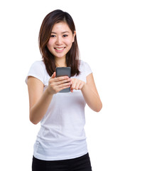 Smiling casual woman use mobile phone
