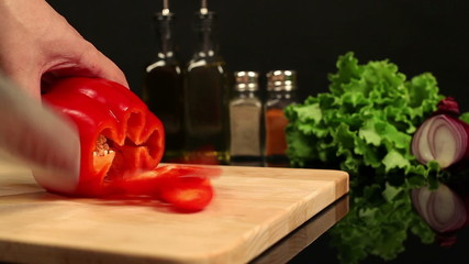 Man chopped red bell pepper on a cutting board