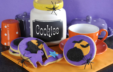 Halloween cookies with spiders and cookie jar.