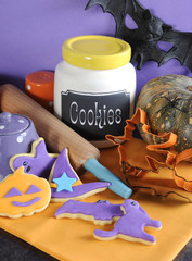 Happy Halloween purple and orange cookies vertical.