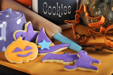 Happy Halloween purple and orange cookies with rolling pin