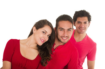 two young men and a young girl dressed in red posing