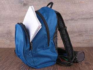 backpack and paper