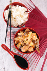 asian cuisine with rice and chicken