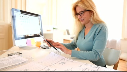 Young attractive woman blonde working at desk