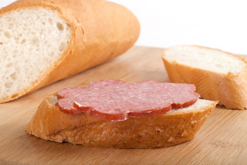 sandwich with boiled-smoked sausage on wood