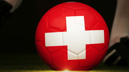 Football player kicking switzerland flag ball