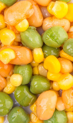 Close up view of baked beans, sweet corn and green peas