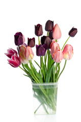 Beautiful bouquet of tulips in transparent vase isolated on whit
