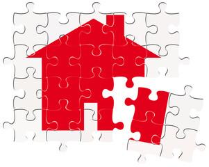 maison rouge sur puzzle, pièces déplacées