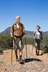 Hiking couple walking on mountain trail