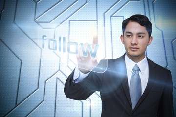 Businessman pointing to word follow