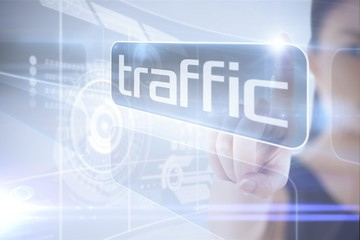 Businesswoman pointing to word traffic