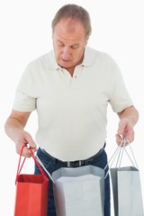 Mature man looking at his purchases
