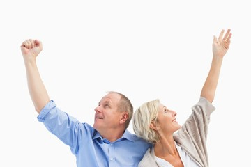 Happy mature couple with hands up