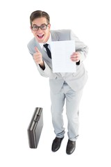 Geeky businessman showing page to camera