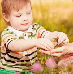 boy sharing flowers