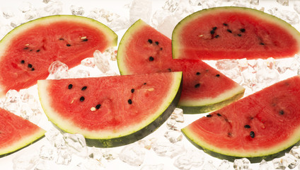 slices of water melon on ice
