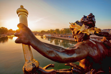 Bridge of Alexander III in Paris against sunset in France