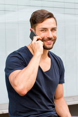 Young smiling man with smartphone