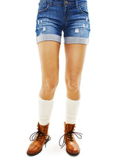Woman in jeans texas shorts on white background