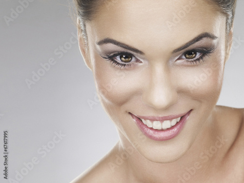 canvas print picture Beautiful face of a young caucasian woman