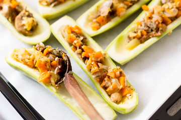 Zucchini stuffed with mixed vegetables