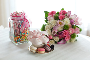 Macaroons, flowers and candy