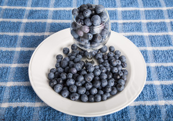 Fresh Ripe Blueberries in Glass and Plate