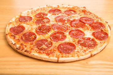 Whole Pepperoni Pizza on Wood Cutting Board