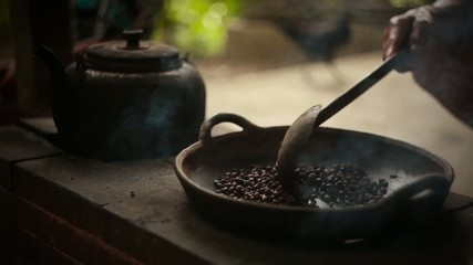 Traditional process of fry coffee beans.