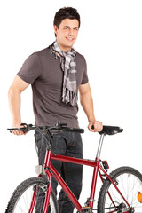 Young man standing next to a bike