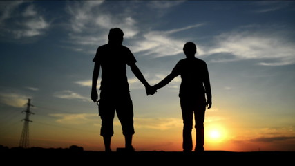 Lovers on a date in sunset, holding hands. Romantic love scene.