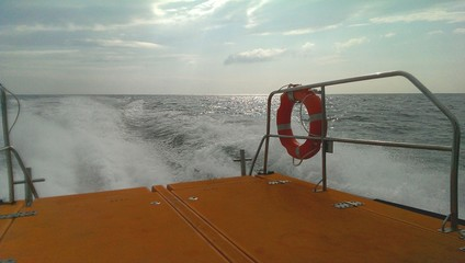 Fast trip on rescue boat, railings and safety ring buoy