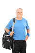 Mature man holding a sports bag