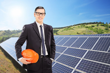 Construction worker in front of solar panels